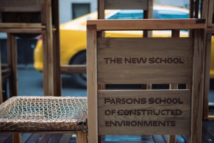 The new school of parsons sign in wood