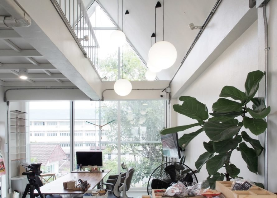 white interior with desks and plants