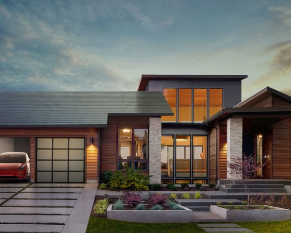 Home with a Tesla Model S in the garage and a Tesla solar roof