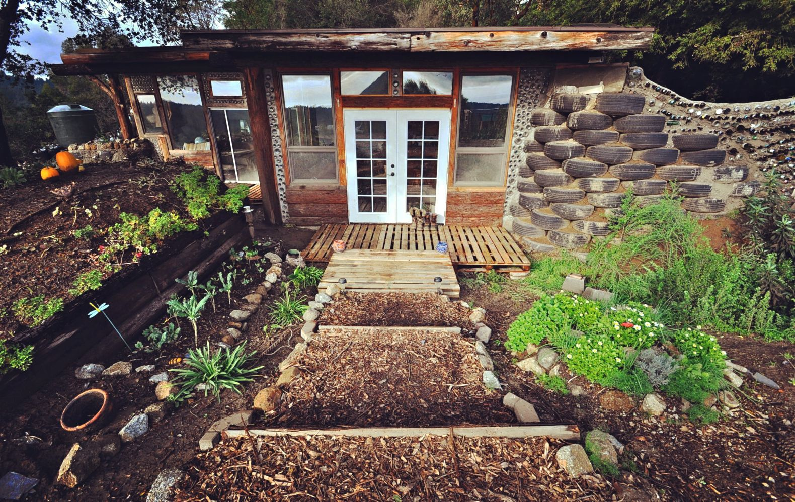 Couple builds an 'Earthship' tiny home for less than $10K