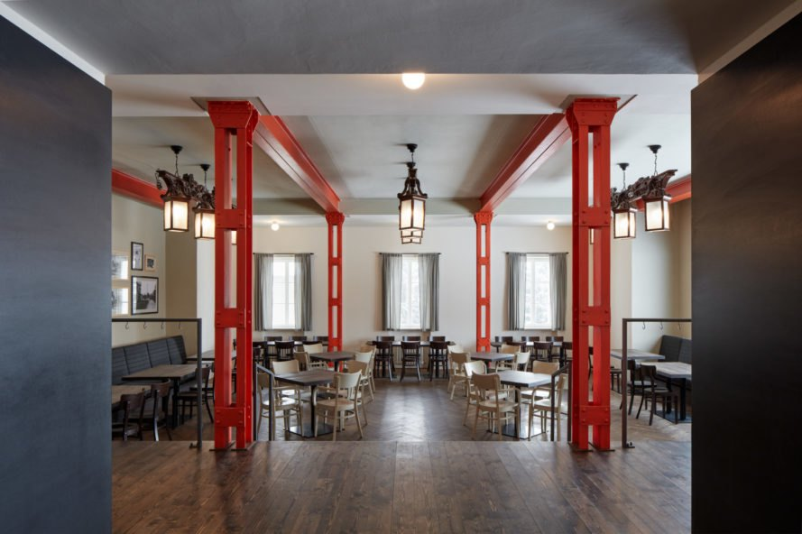 restaurant area with seats and red pillars