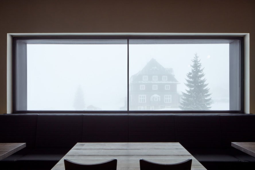 seats and table looking out over a white landscape