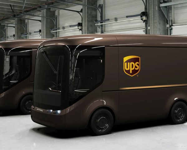 New UPS and ARRIVAL electric vans inside a warehouse