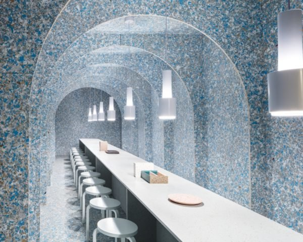 Zero Waste Bistro interior with blue walls and a long narrow dining table