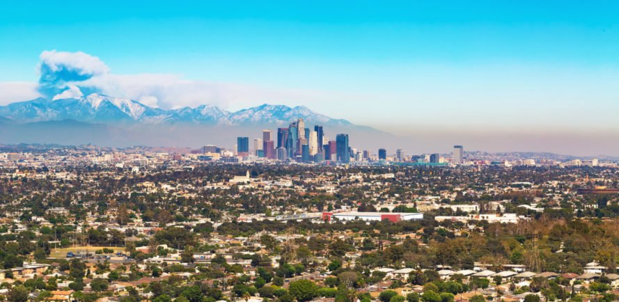 Smoke from forest fire rising behind LA skyline