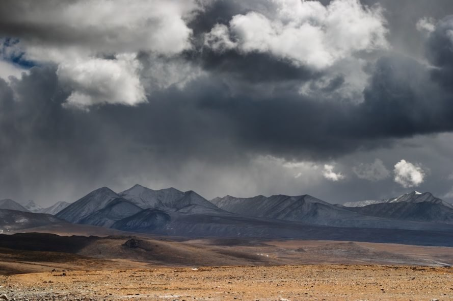 Clouds gather over the mountains and plains of the Tibetan Plateau