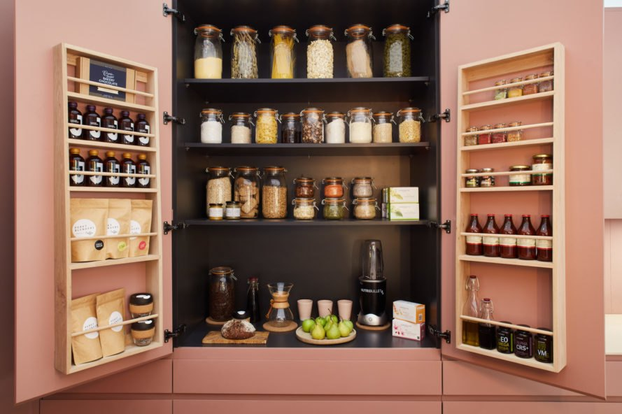 kitchen cupboard with jars and bottles