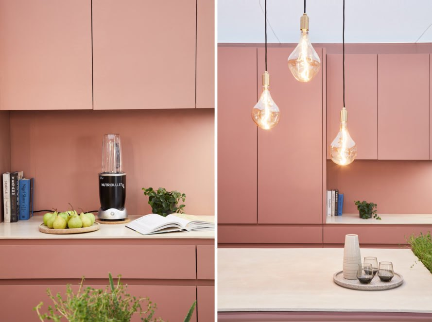 Rose colored kitchen with hanging lights