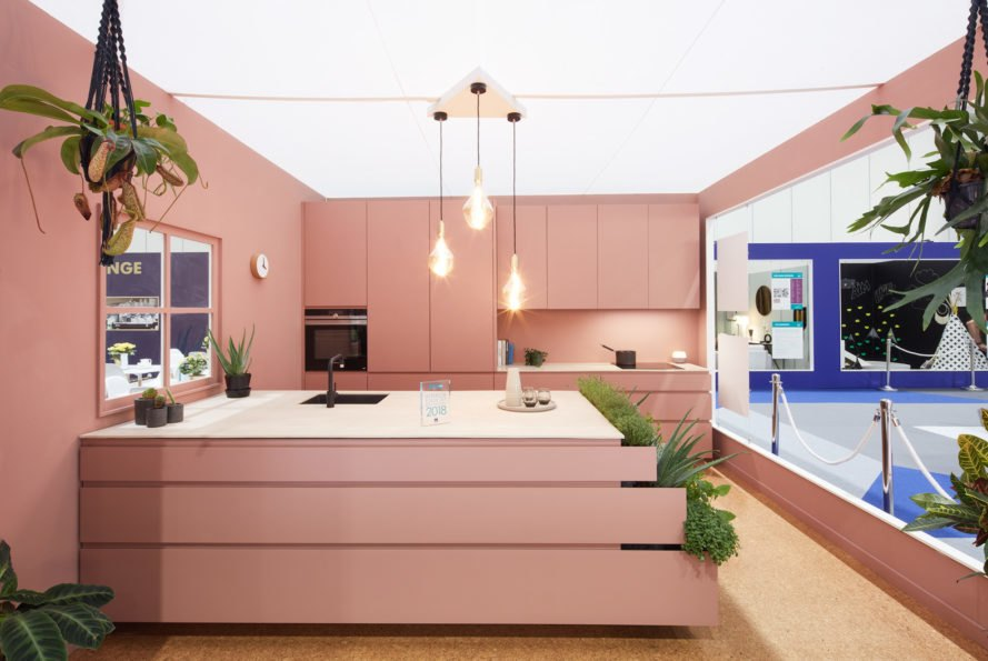 rose colored kitchen with green plants
