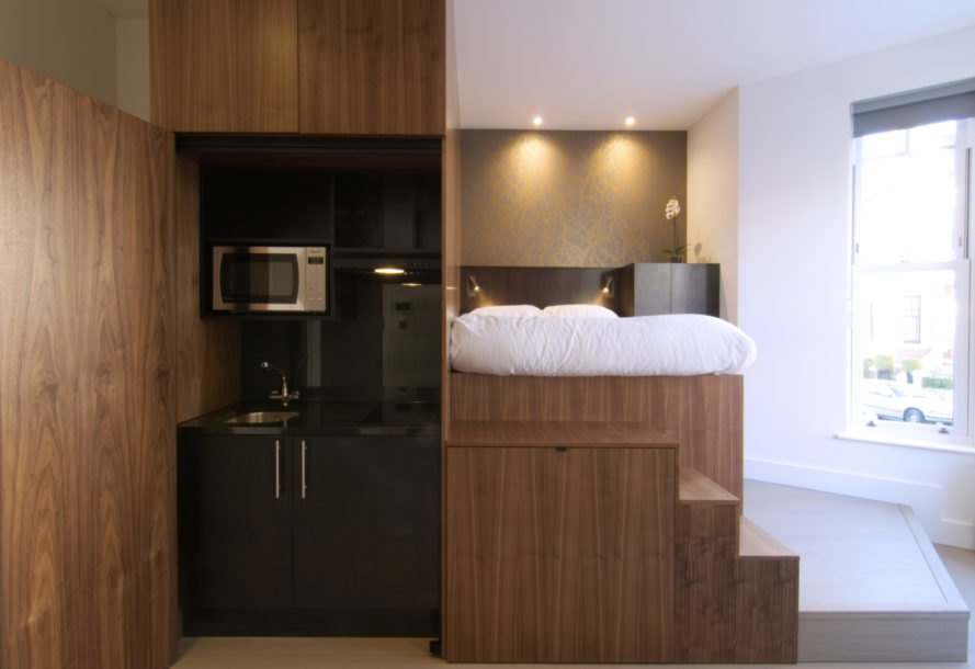 multifunctional unit with bed and kitchen
