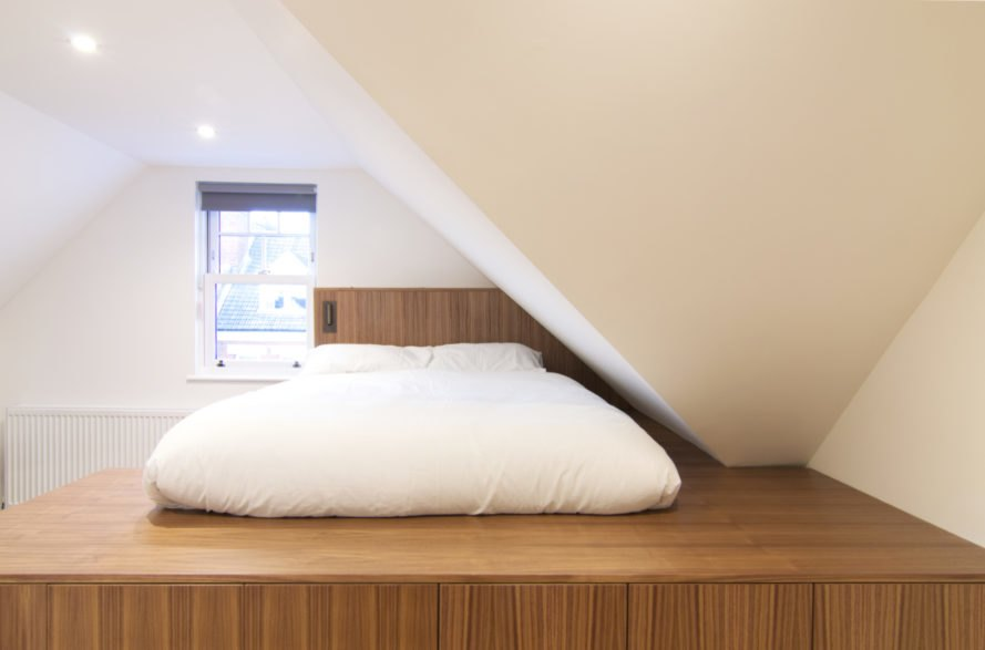 white bed on wooden platform