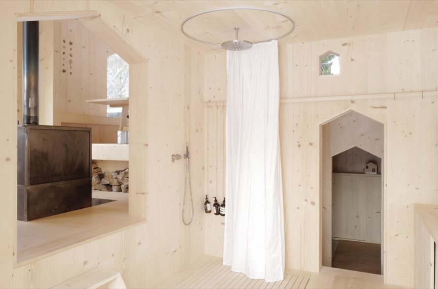 Shower head from the ceiling with circular white curtain