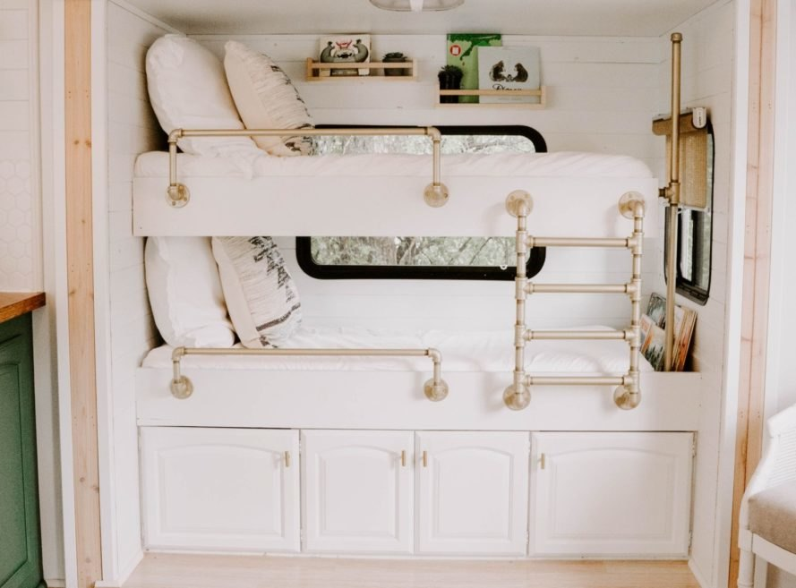 two bunk beds with white linens