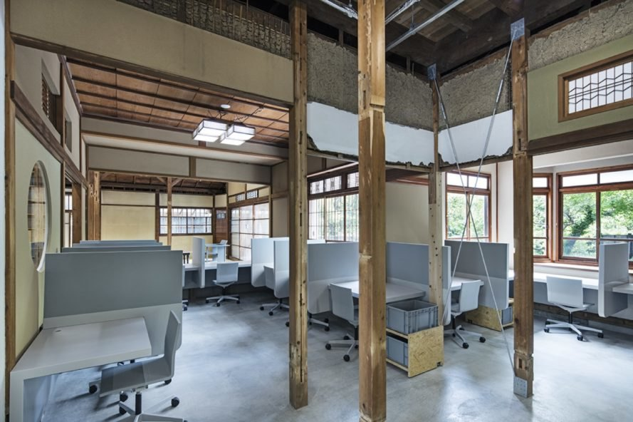 office area with several cubicles and rolling chairs