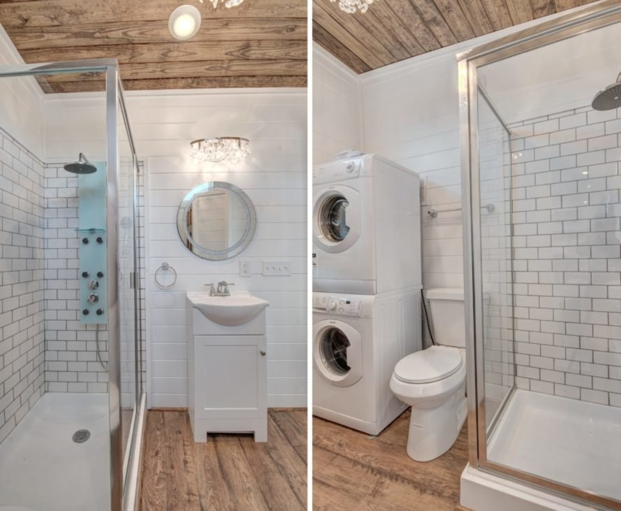 all white bathroom with wooden flooring and ceiling.