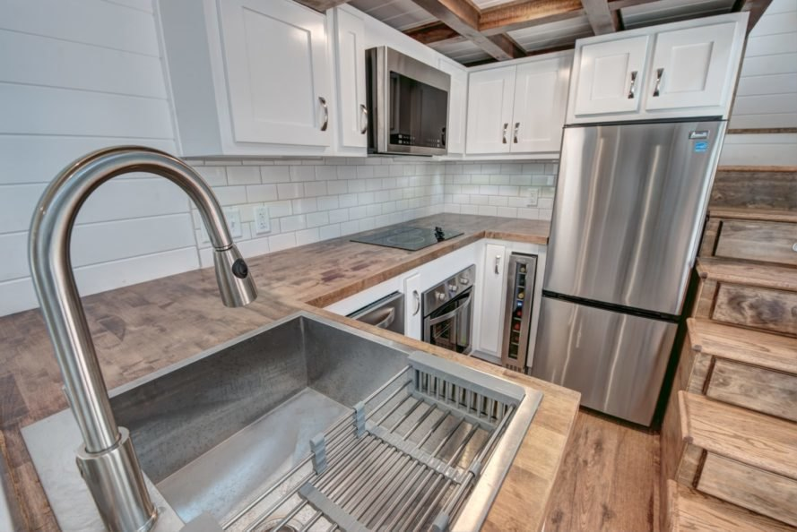 stainless steel sink with wooden countertop