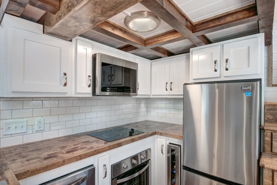 kitchen area with all white cupboards and wooden accents