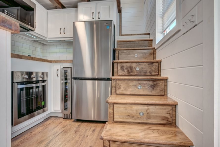 kitchen space with stairs leading upstairs