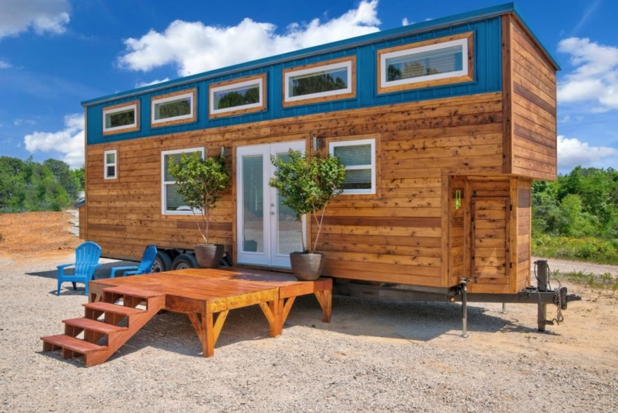 cedar tiny home with blue accents