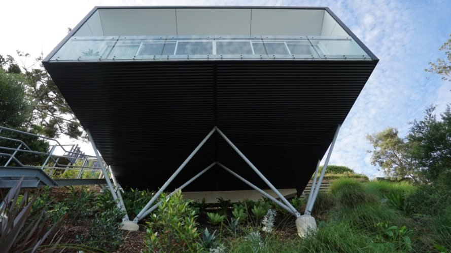 Black cube home on stilts