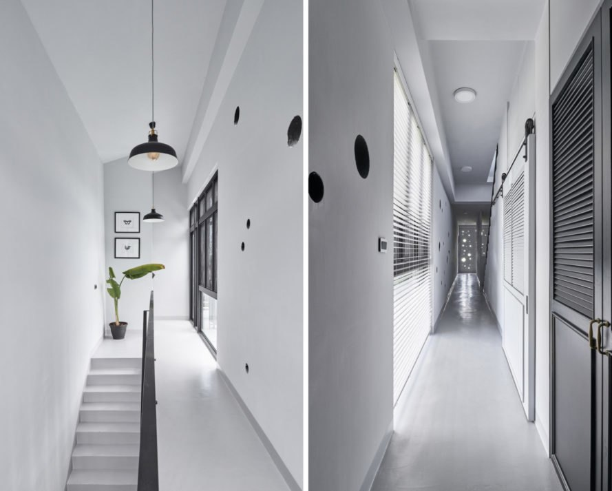 all white interior hallway with black accents