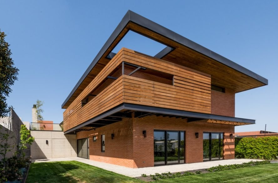 a brick and wooden-clad home