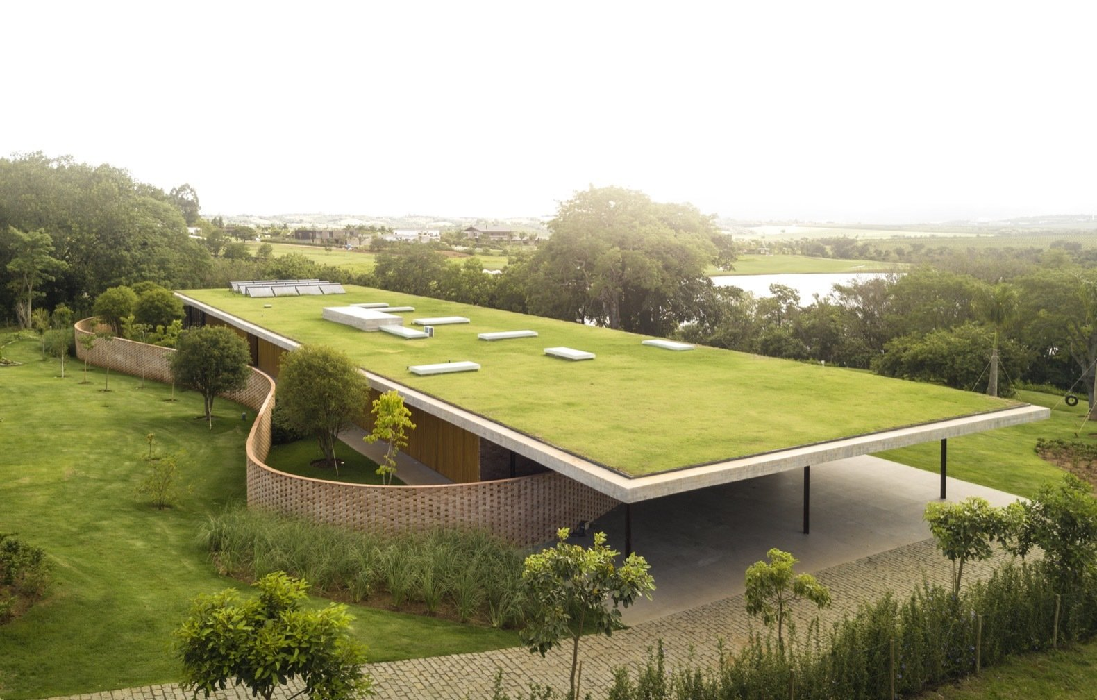 This modern solar-powered retreat is topped with a massive green roof