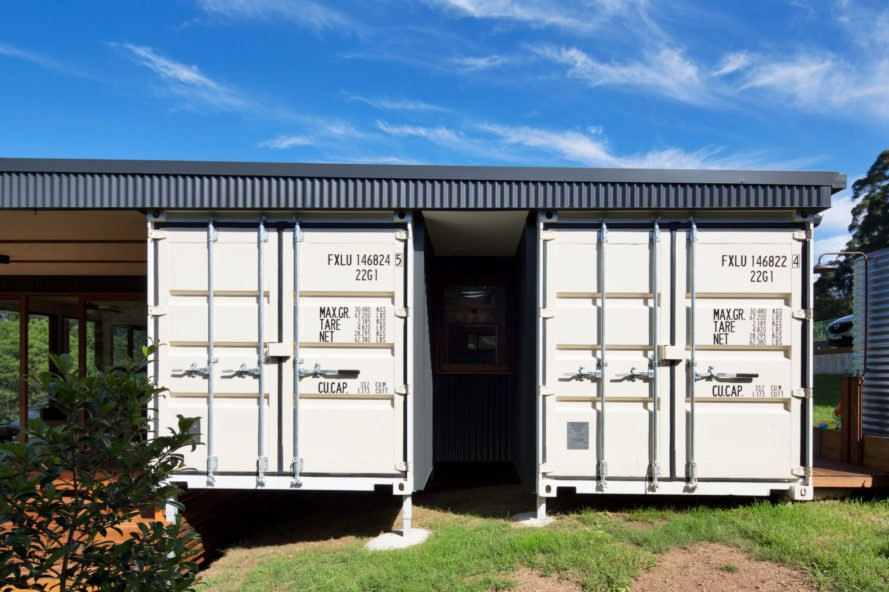 four white shipping container doors