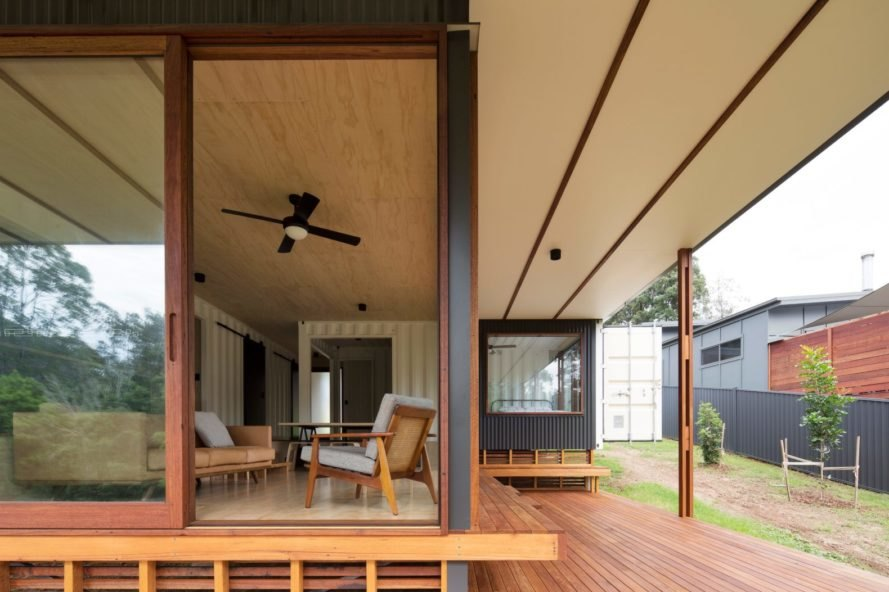 a wooden deck with covered and open air space