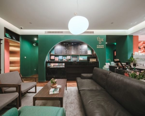cafe with green walls and dark furniture in bookstore