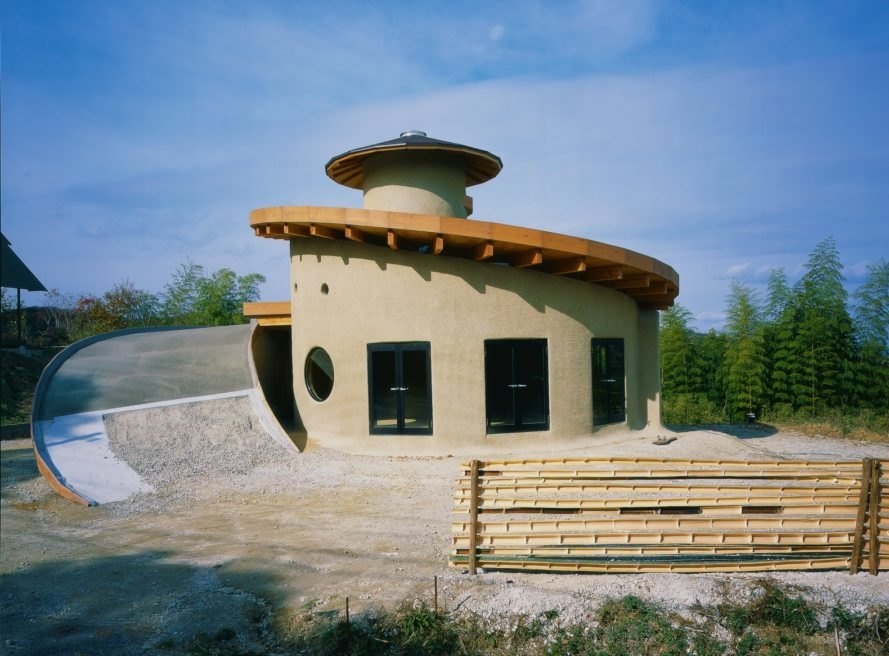 a round home with a spiraling rooftop