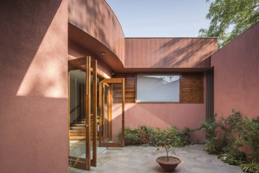 Curved facade with wood accents