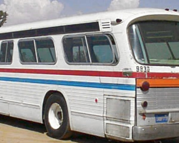 old white bus with red and blue striping