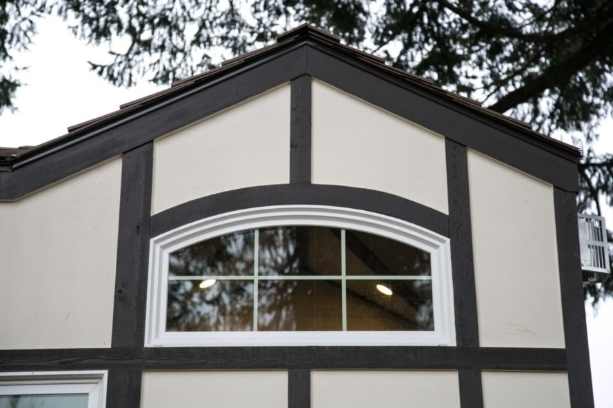pitched roof with curved window