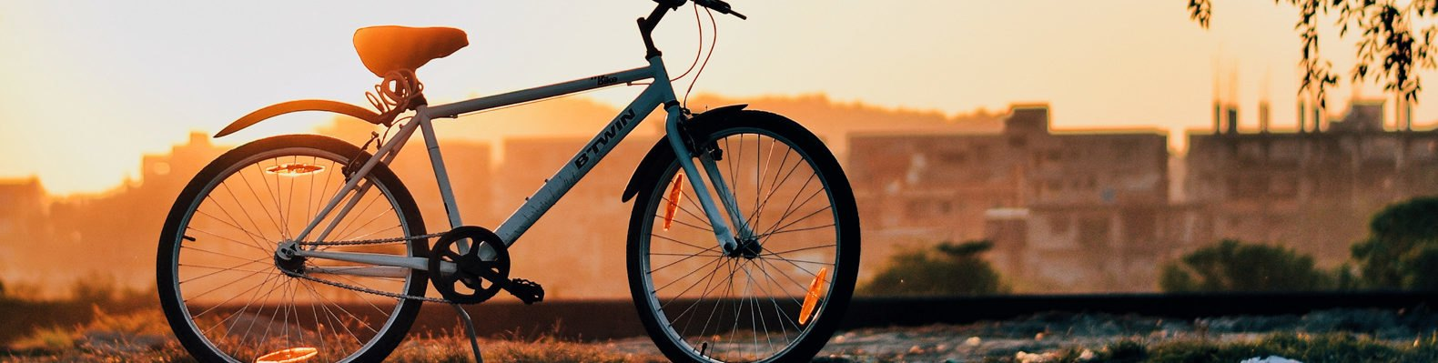 Bike at sunset with city skyline in background