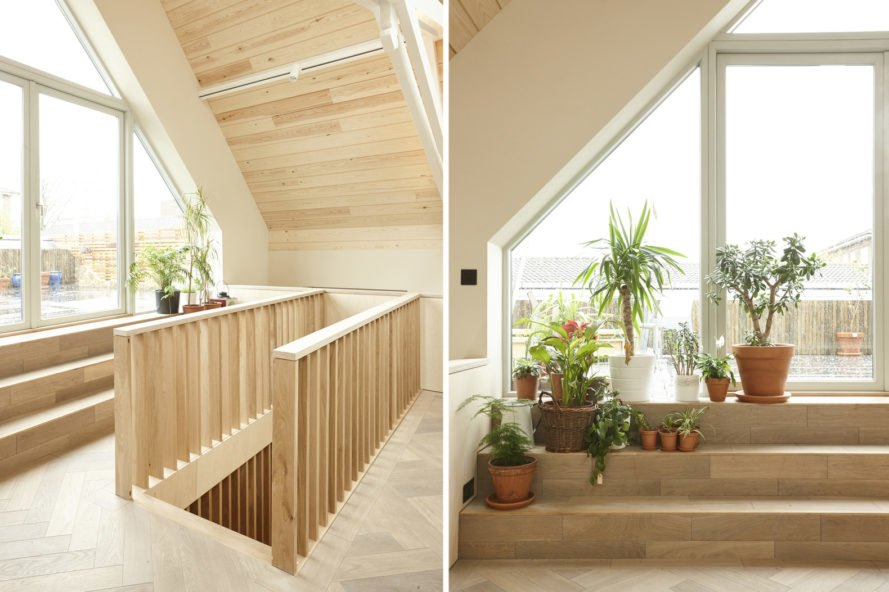 On the left, stairs to the mezzanine. On the right, roof terrace with plants.