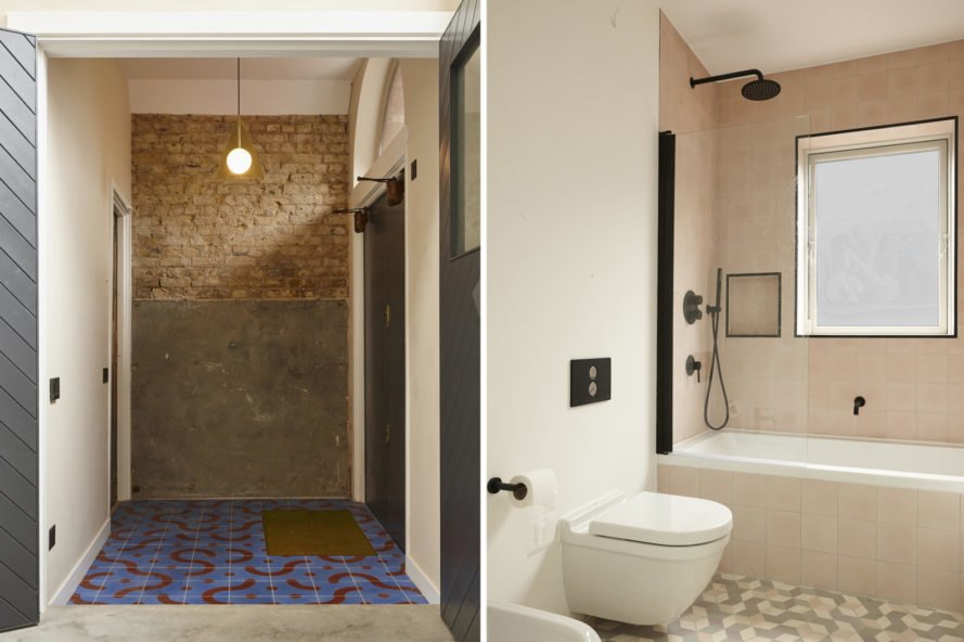 On the left, exposed brick wall. On the right, bathroom with walk-in shower.