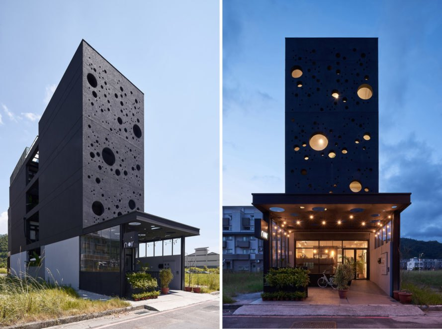 Tall black building with multiple round windows