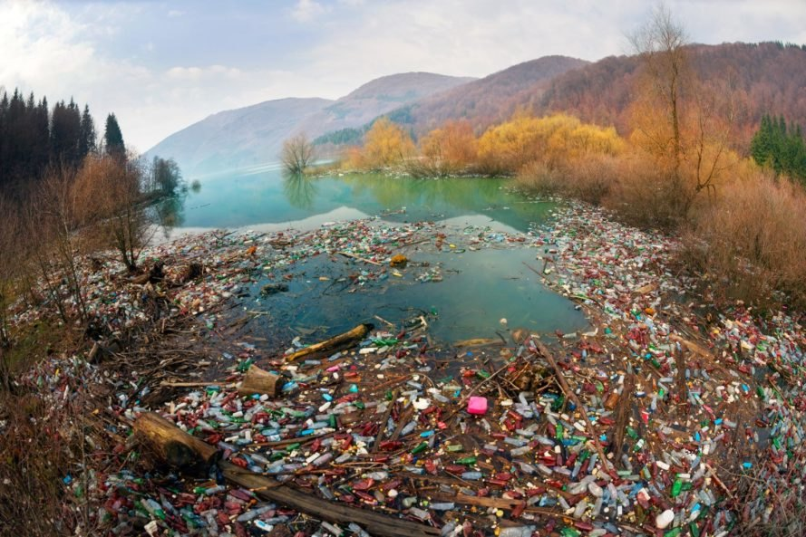 Plastic waste in water near mountains