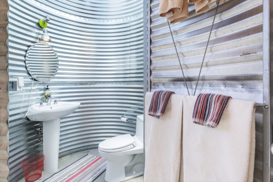 bathroom inside a rounded corrugated metal room