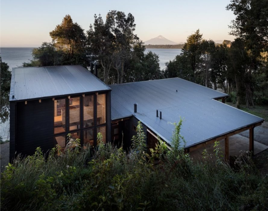 flat roof of wooden home surrounded by trees