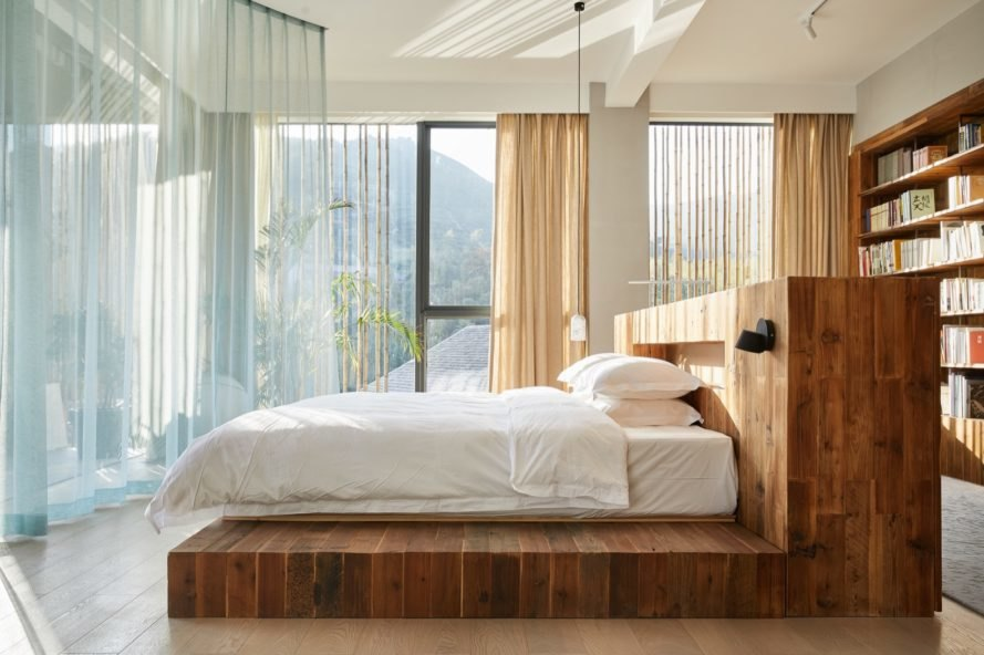 sky room with bed on a wood platform