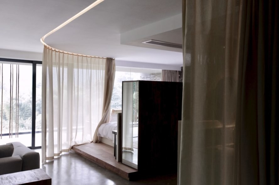 bamboo room with canopy-like curtains around the bed