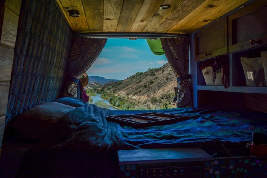 bed with view overlooking mountains