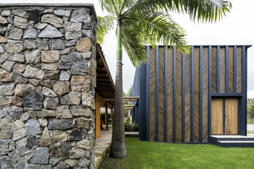 Home with stone and herringbone-patterned bamboo exterior