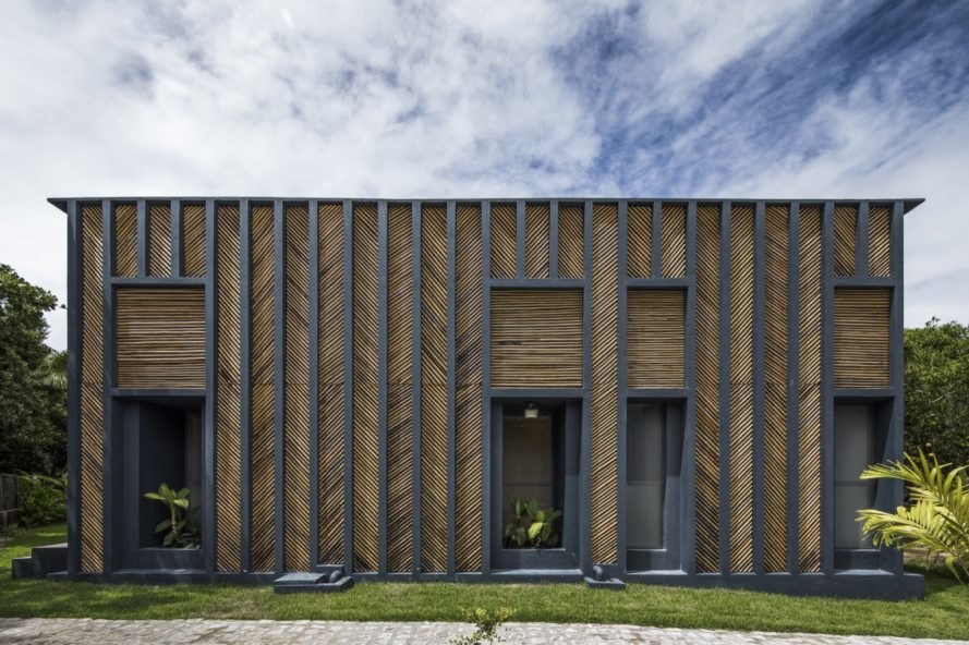 Herringbone-patterned bamboo paneling and openings that house plants