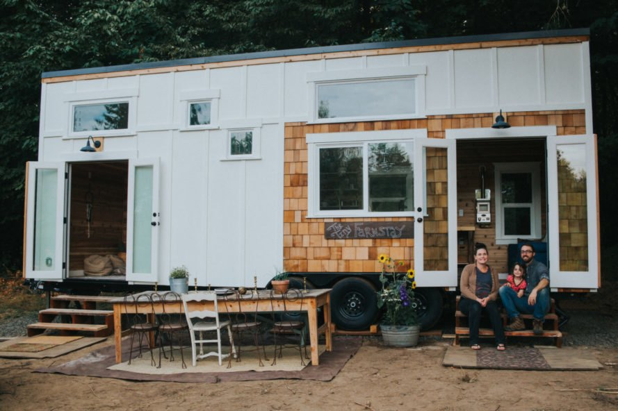 small home exterior with white panels and cedar siding