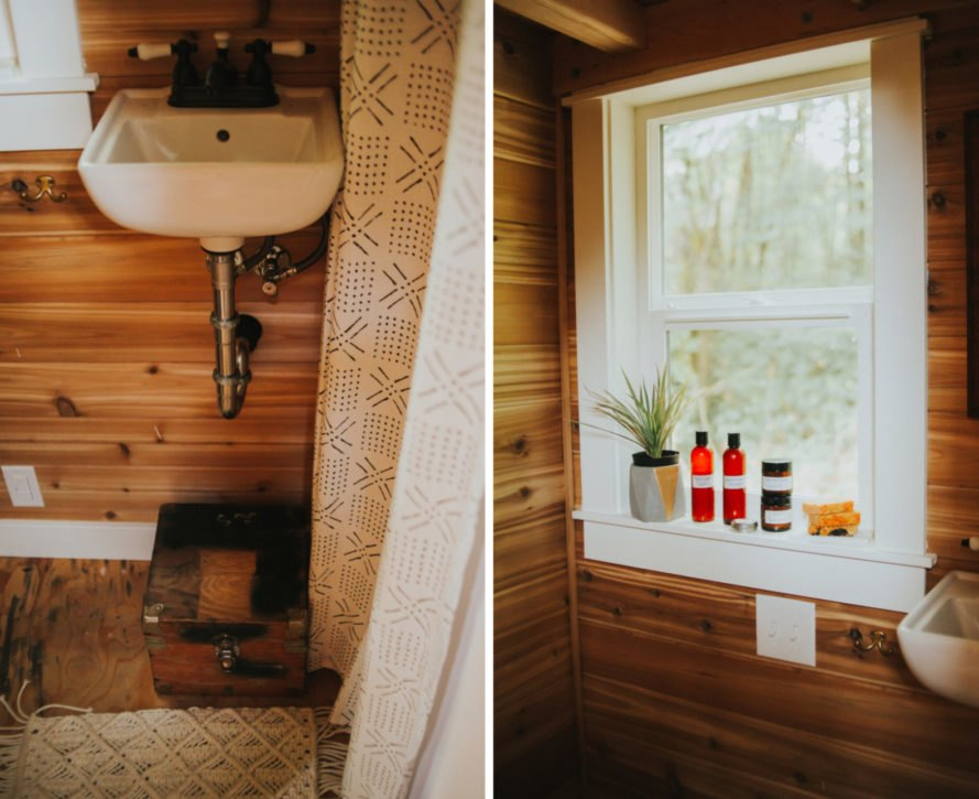a small, wood clad bathroom with window