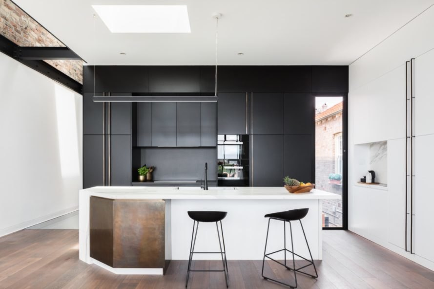 kitchen with white island and black cabinetry