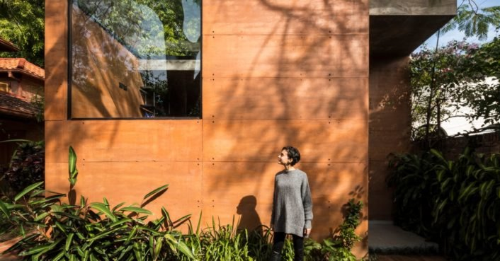 Architects build their own rammed-earth office around existing